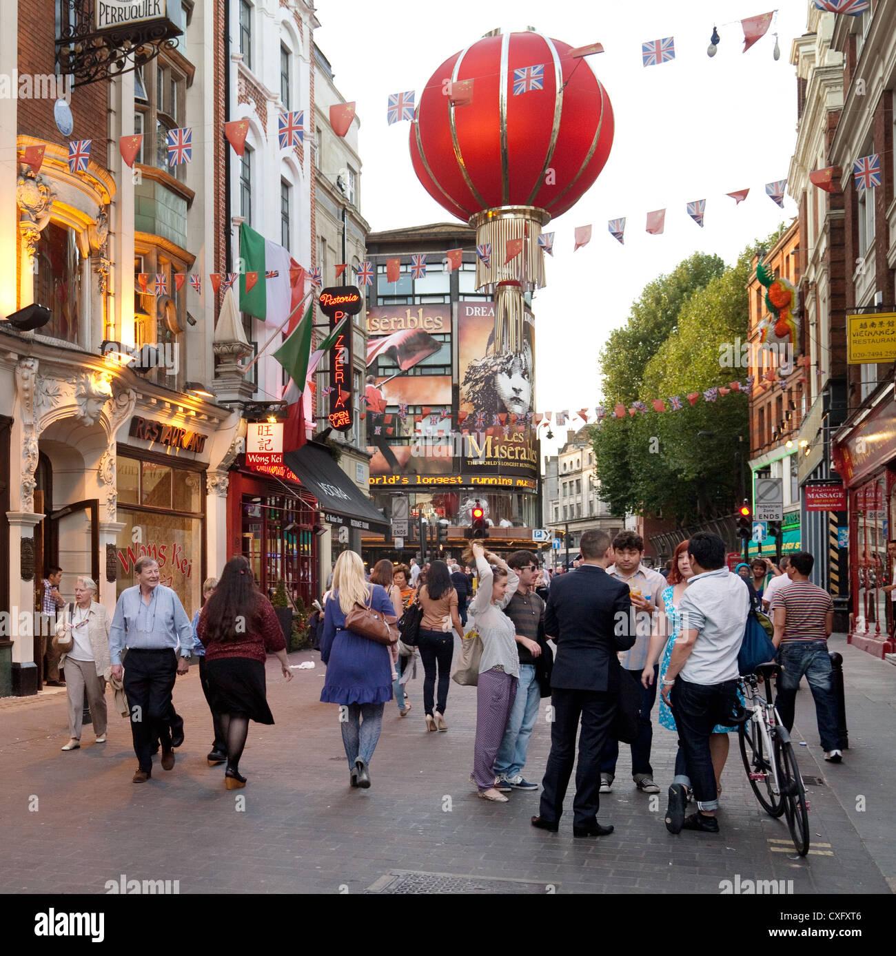 Street scene, early evening, Wardour St, Chinatown, london W1D, UK - Stock Image