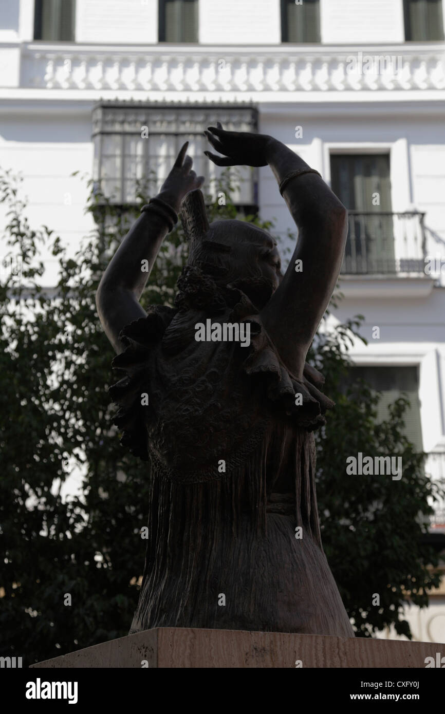 Bronze statue of a Flamenco dancer woman in central Seville Spain - Stock Image