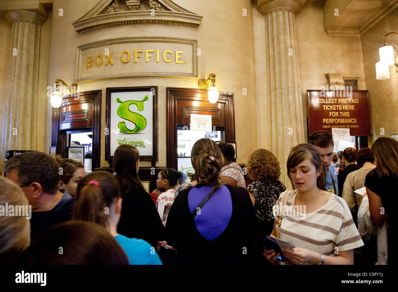People coming to see Shrek the Musical in the Box Office of the Theatre Royal Drury Lane, West End London UK - Stock Image