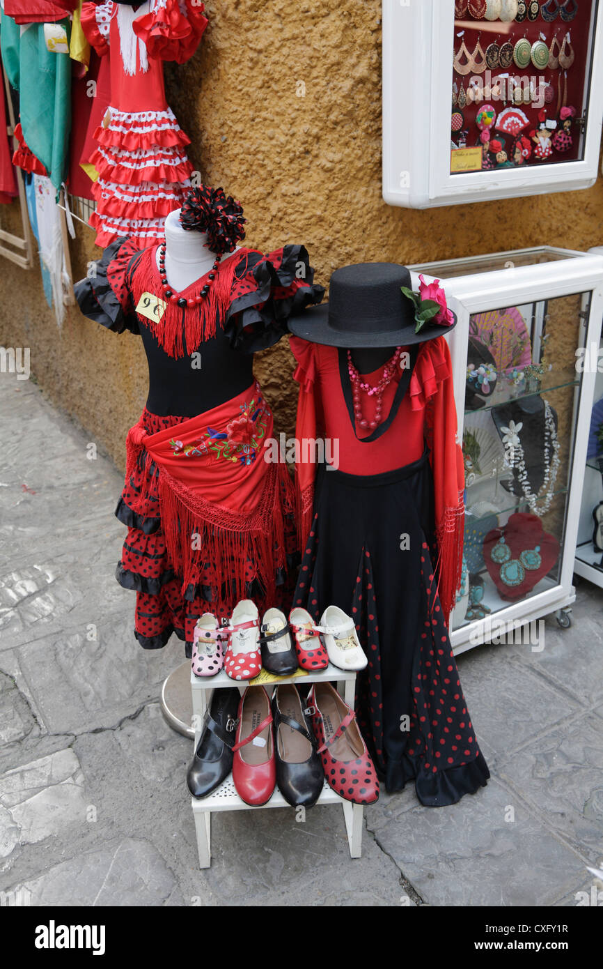 Souvenir shop in Seville Spain selling flamenco dresses hats and shoes - Stock Image