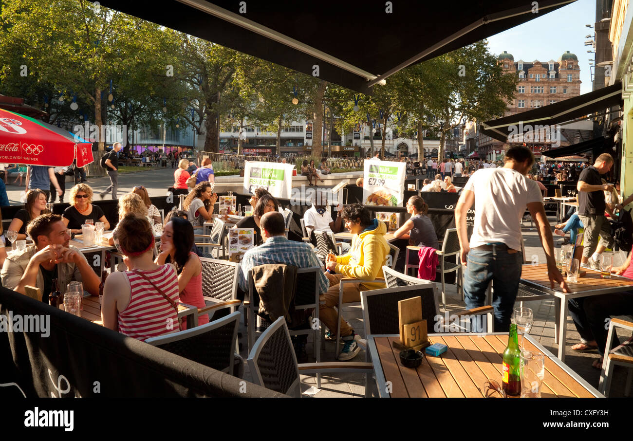 people at a cafe bar in the early evening, Leicester Square, London WC2 UK Stock Photo