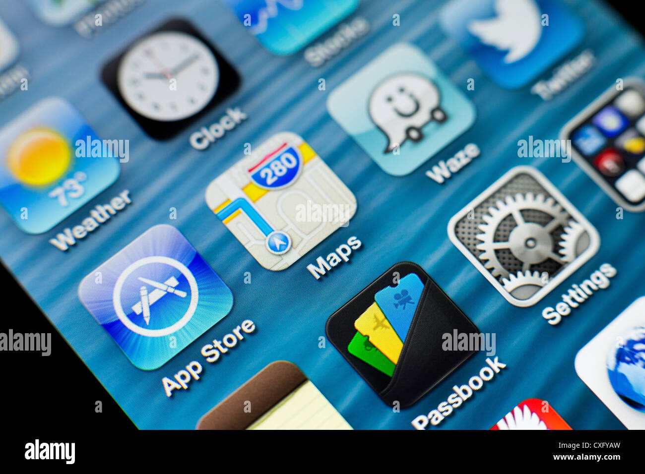 Screen of the new iPhone 5 showing new and problematic Maps app and other various apps: Passbook Twitter App Store Stock Photo