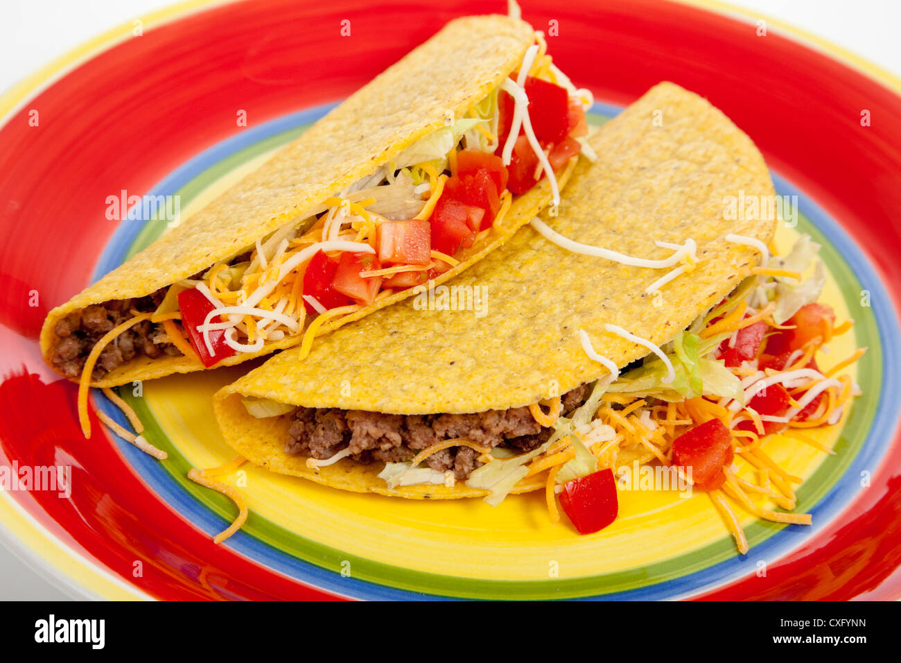 Beef tacos on a colorful plate - Stock Image