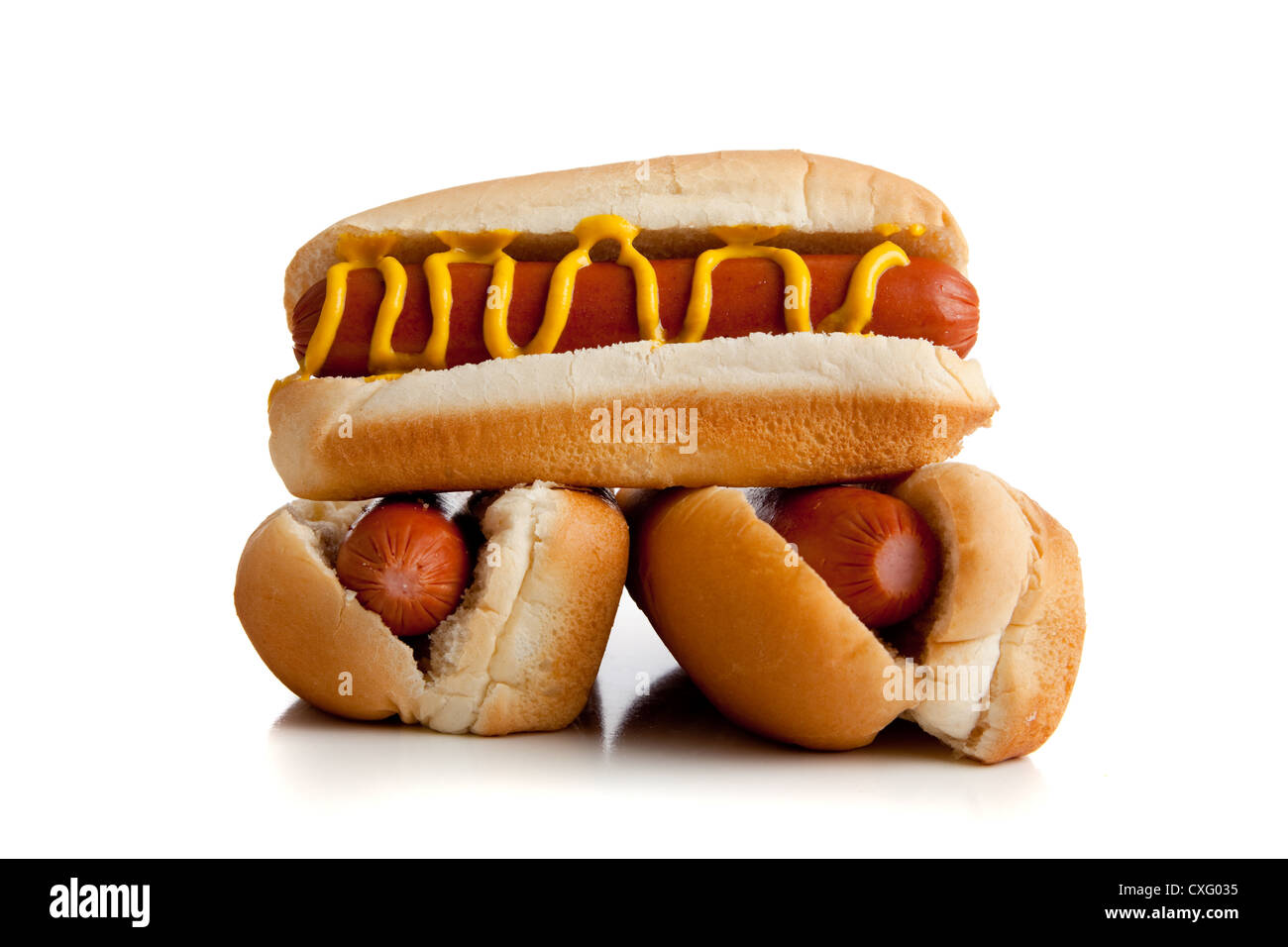 stack of three hot dogs with mustard - Stock Image