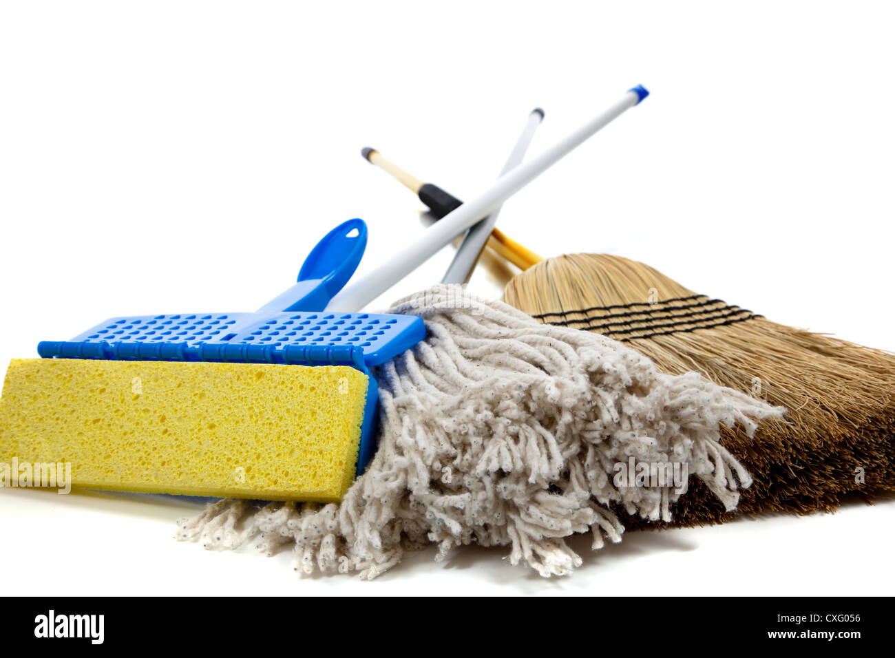 sponge and string mop with a straw broom - Stock Image