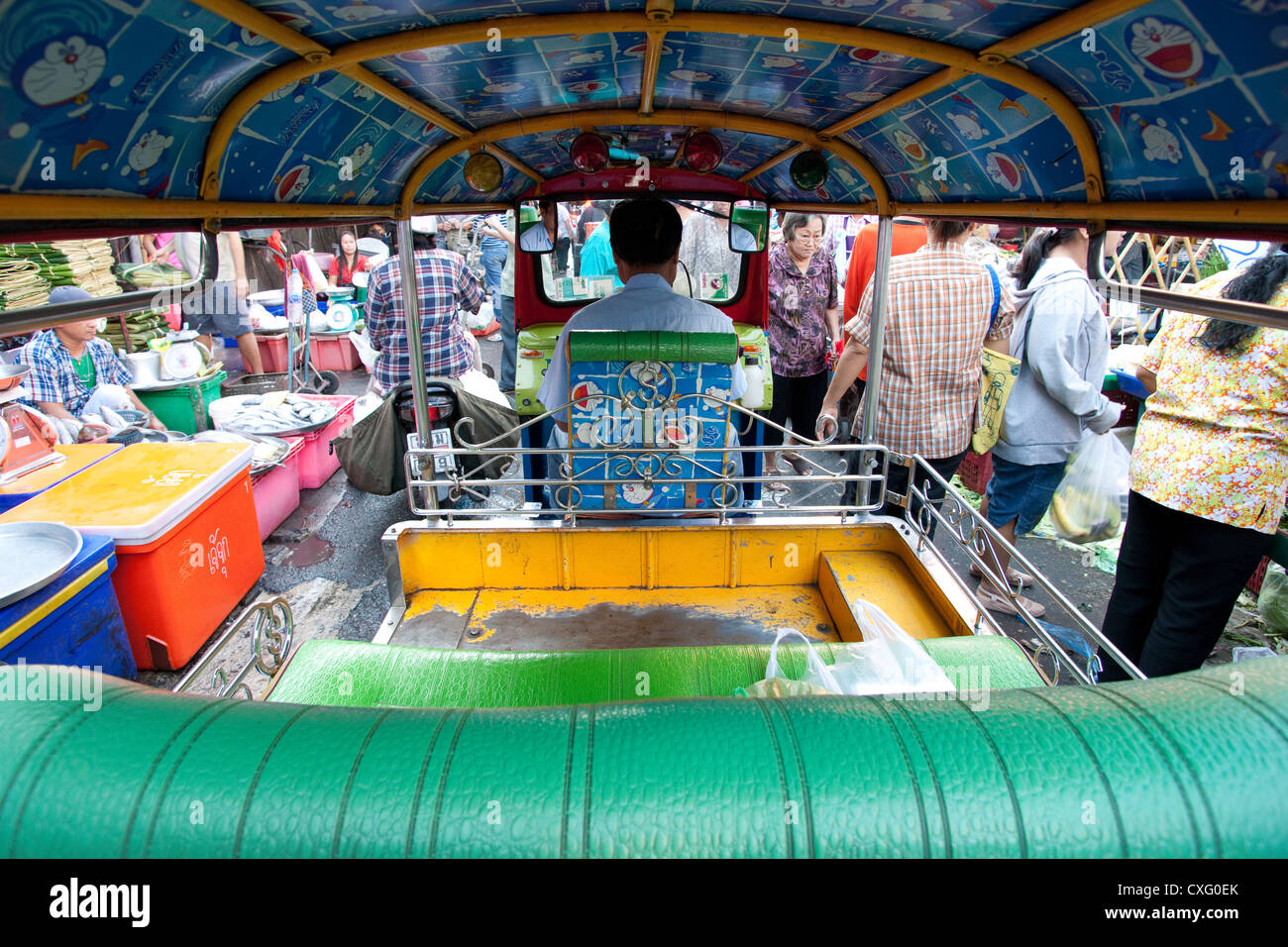 A view looking out from inside a Tut Tut in the market Bangkok Thailand - Stock Image