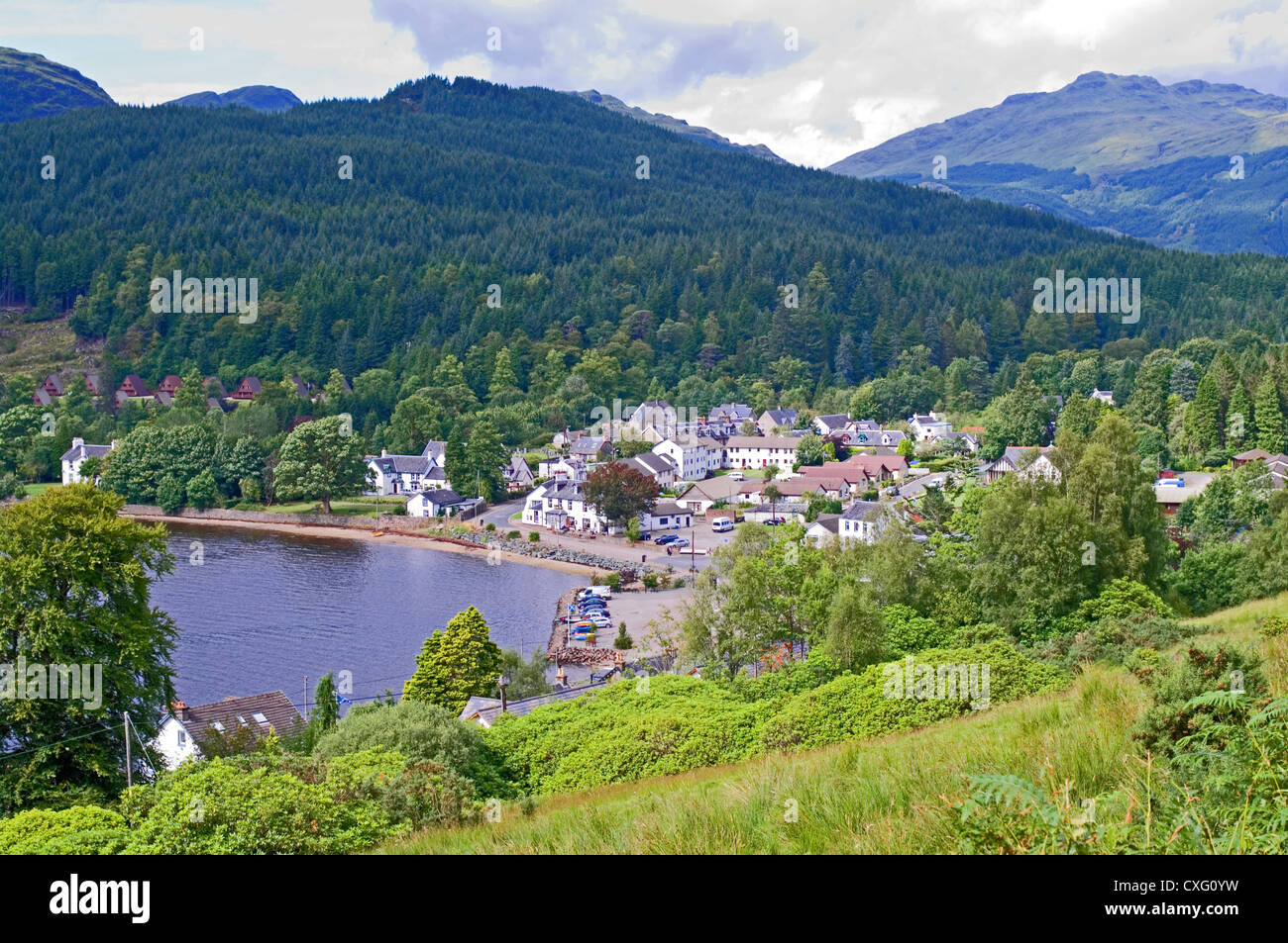 Looking down on village of Lochgoilhead, Loch Goil, Drimsynie holiday lodges on left, Ardgoil, Argyll Forest Park, - Stock Image