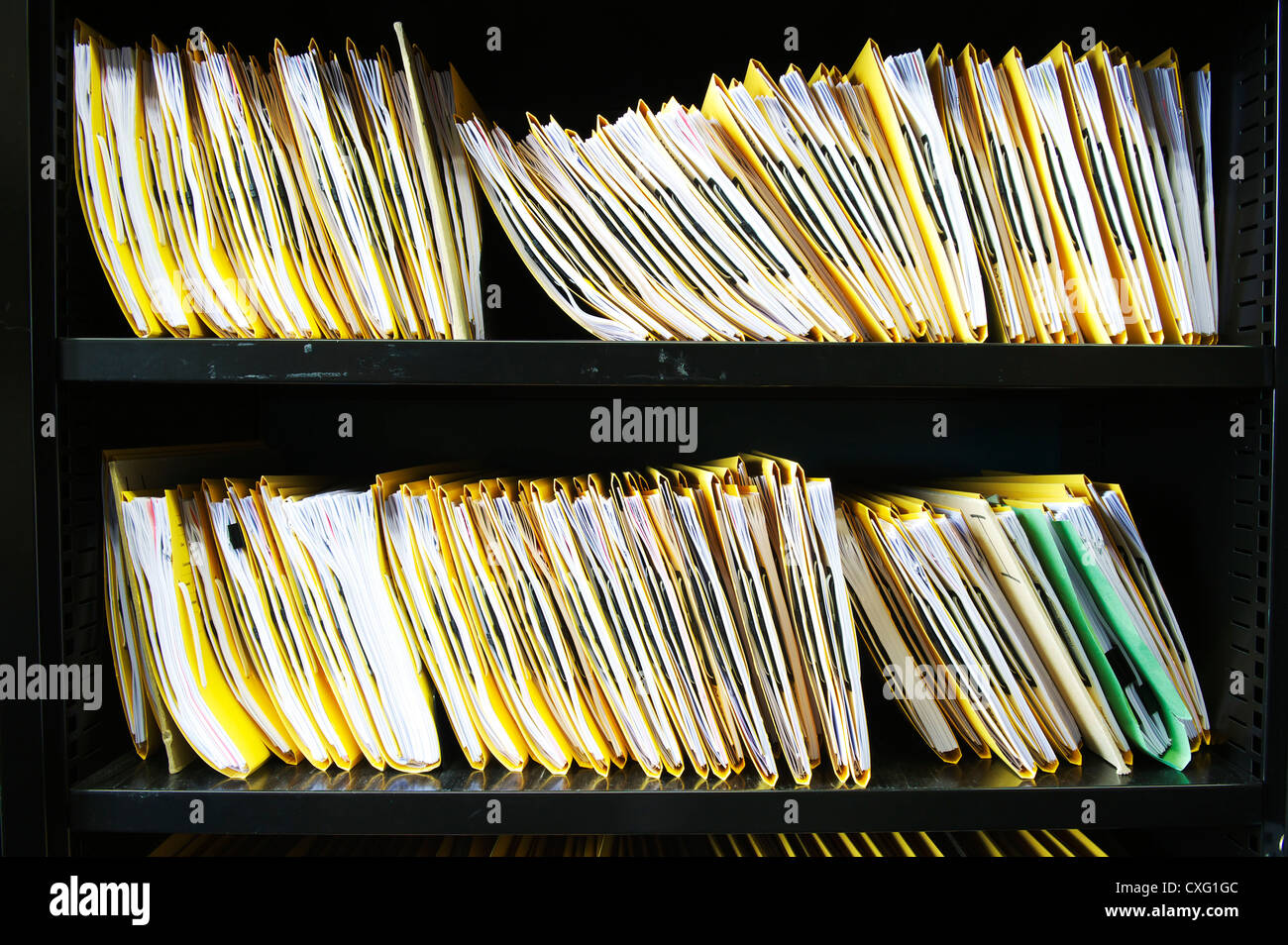 confidential medical and business files sitting on office shelves - Stock Image