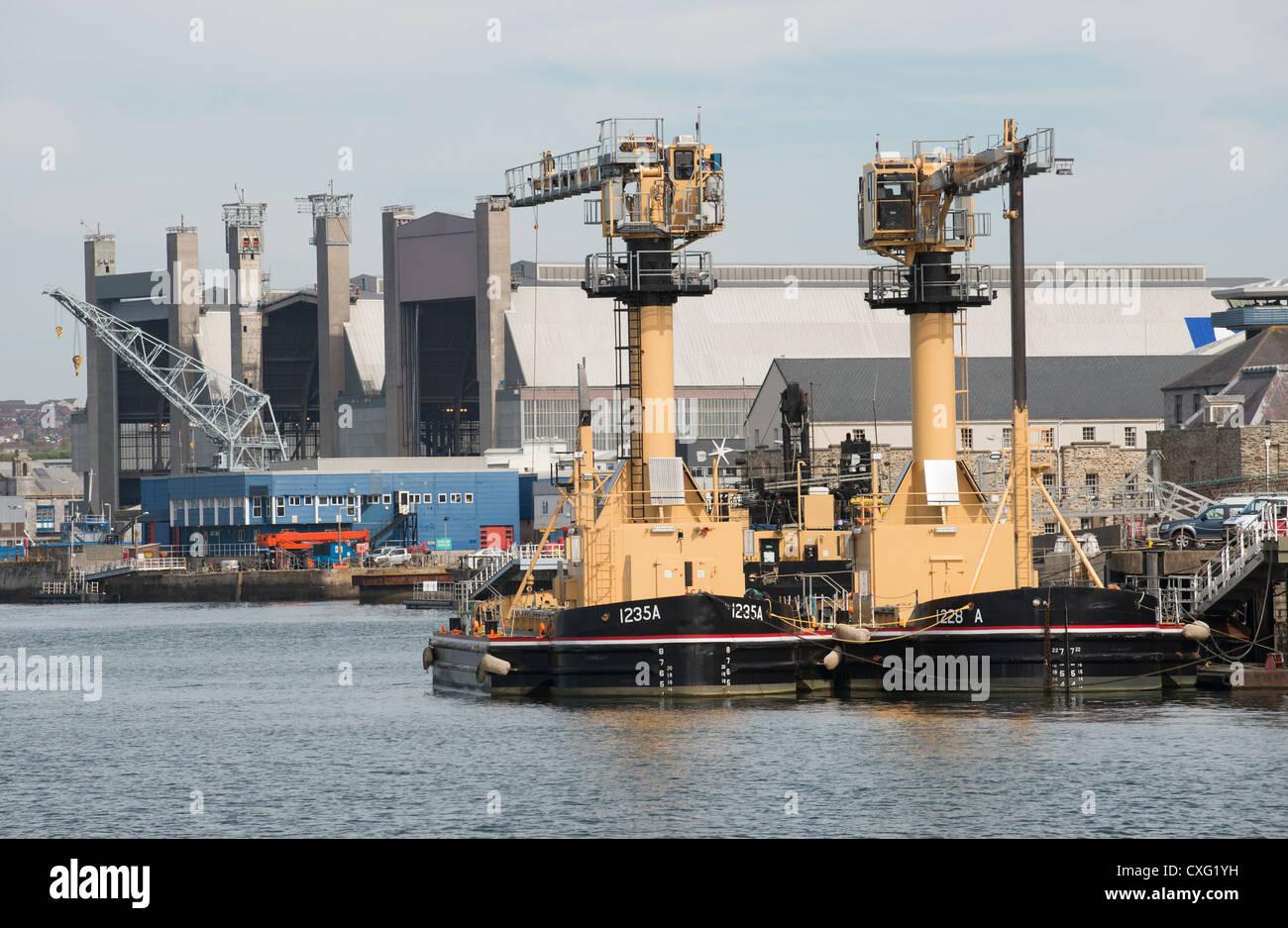 Ammunition loading barges Devonport Royal Dockyard Plymouth Devon UK Stock Photo