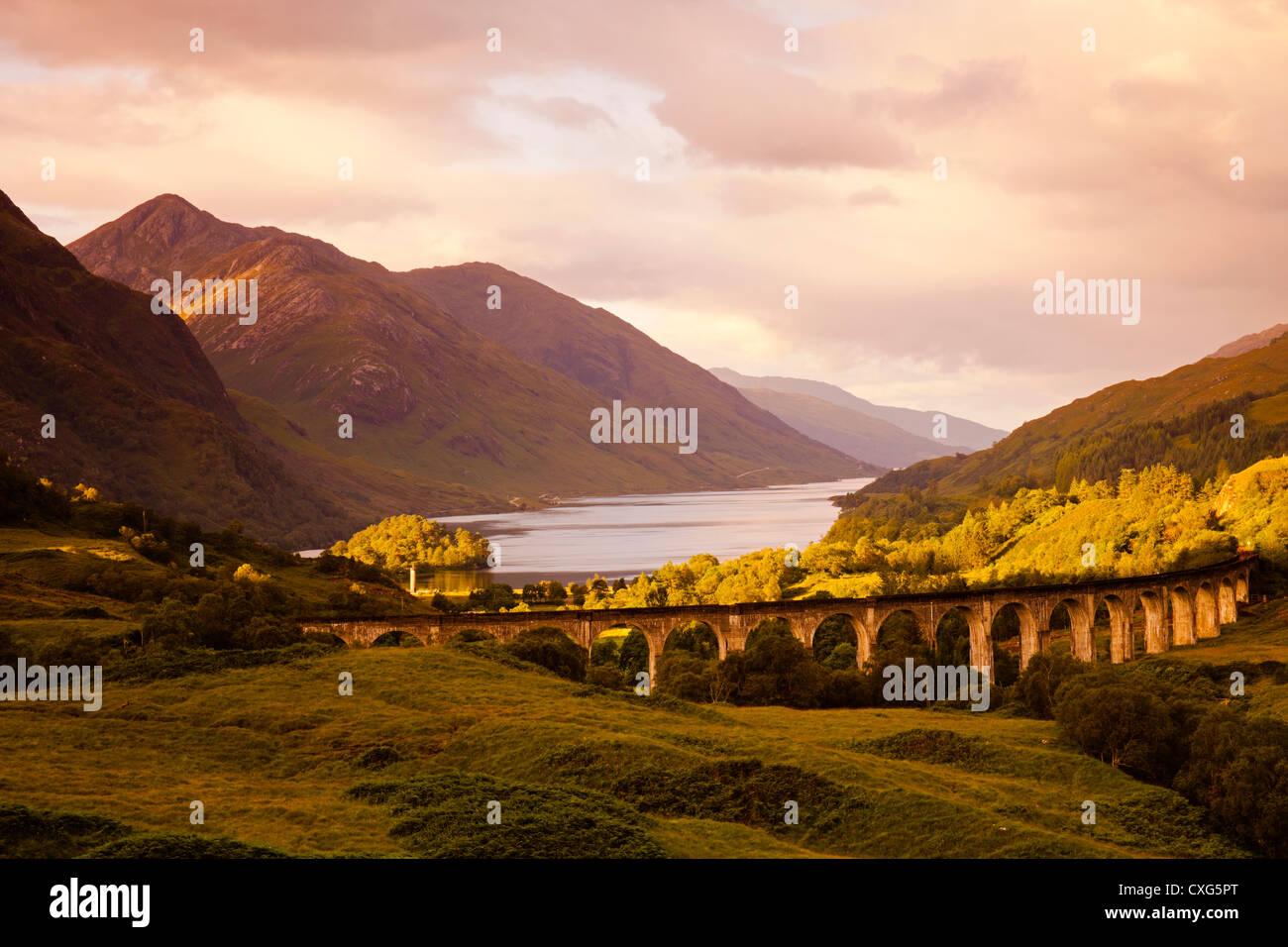 Glenfinnan Viaduct at sunrise with Loch Shiel, Lochaber, Scotland, UK, Europe - Stock Image