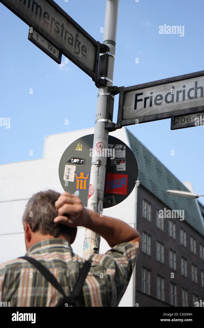 Berlin Tourist in Friedrichstrasse scratching his head - Stock Image