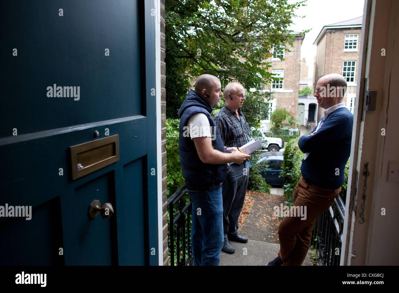 Bailiffs outside a residential address in London, UK - Stock Image
