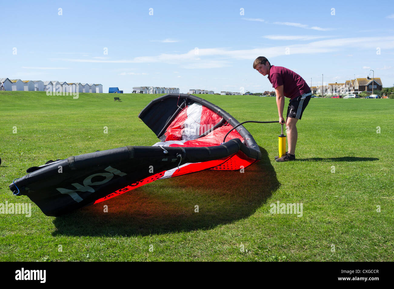 Inflating a large kite - Stock Image