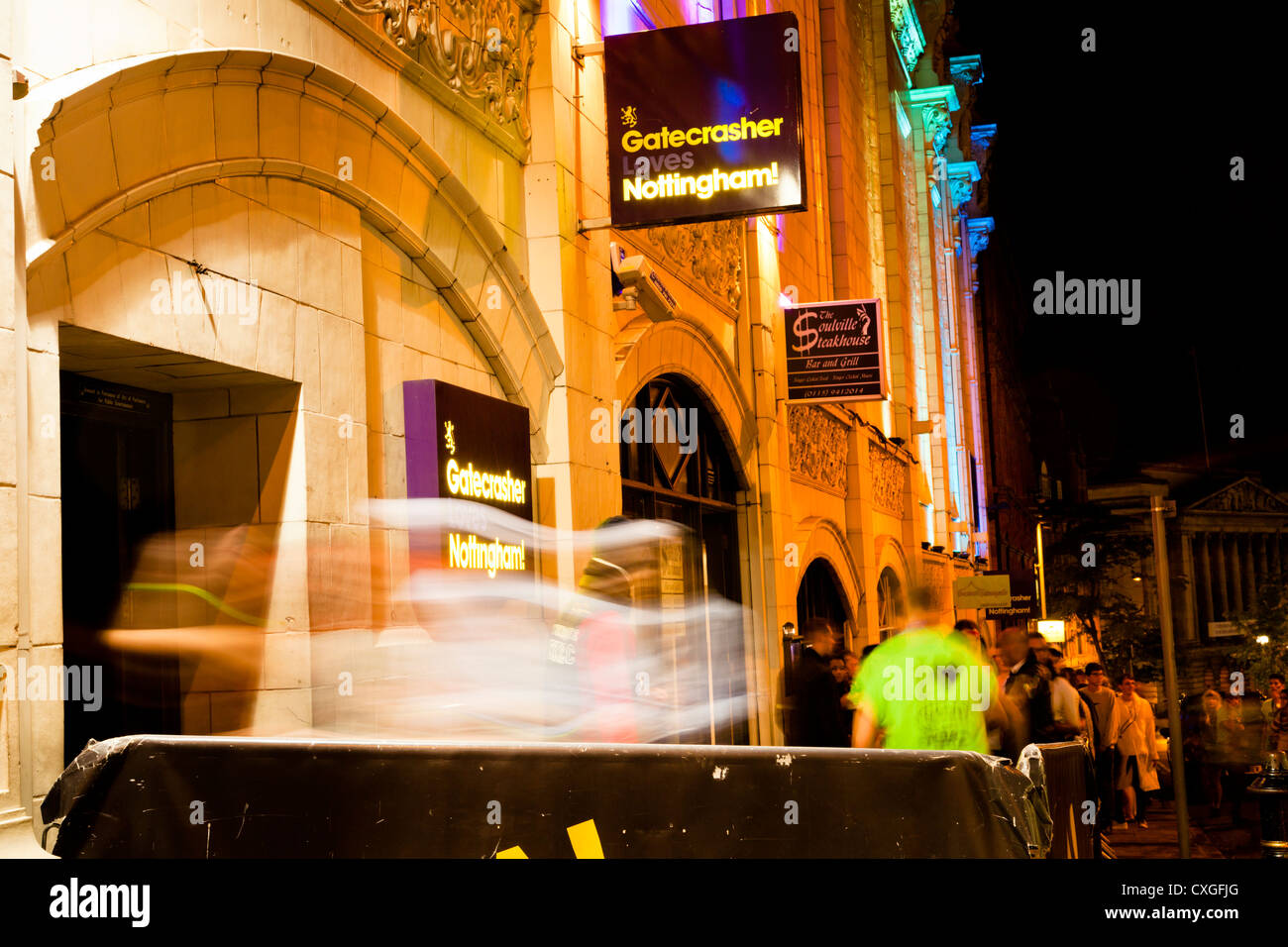 Motion blur of people queueing and entering a night club. Student night at Gatecrasher nightclub, Nottingham, England, - Stock Image