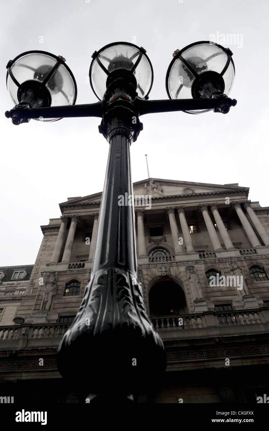 A gloomy low angle view of street lamps and the front of the Bank of England Threadneedle Street London, England - Stock Image
