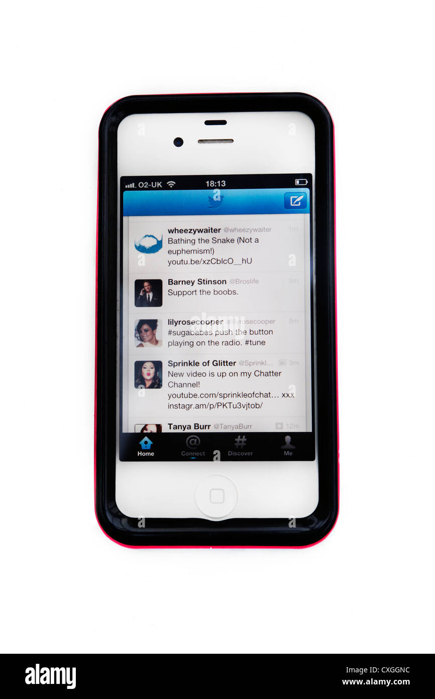 iPhone 4S With Skin Showing Tweets On Twitter - Stock Image