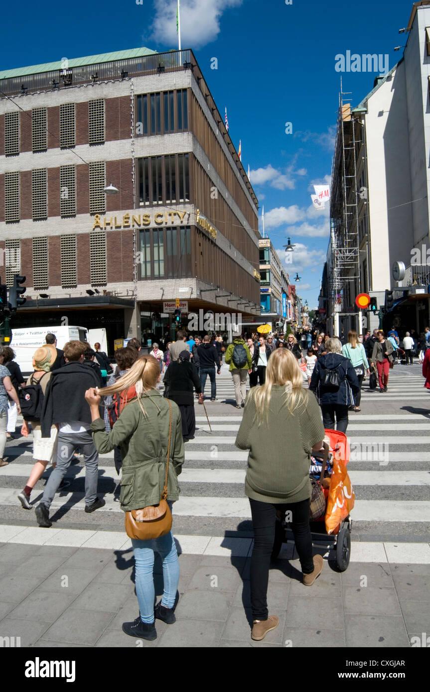 street scene in Stockholm Sweden Swedish capital Scandinavia Scandinavian Scandinavians people swedes blonde blonde's - Stock Image