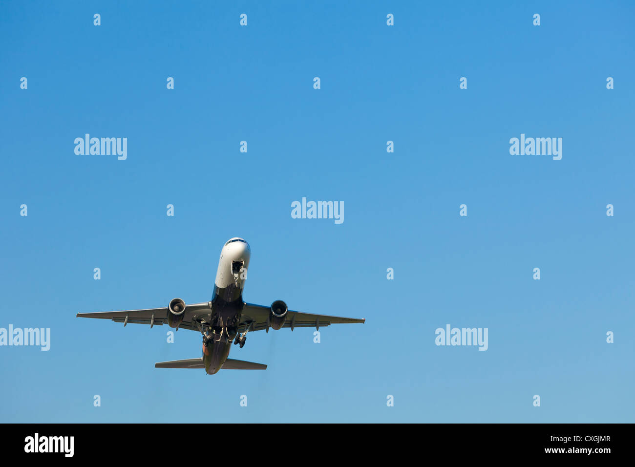 Airplane airborne after take off, England - Stock Image