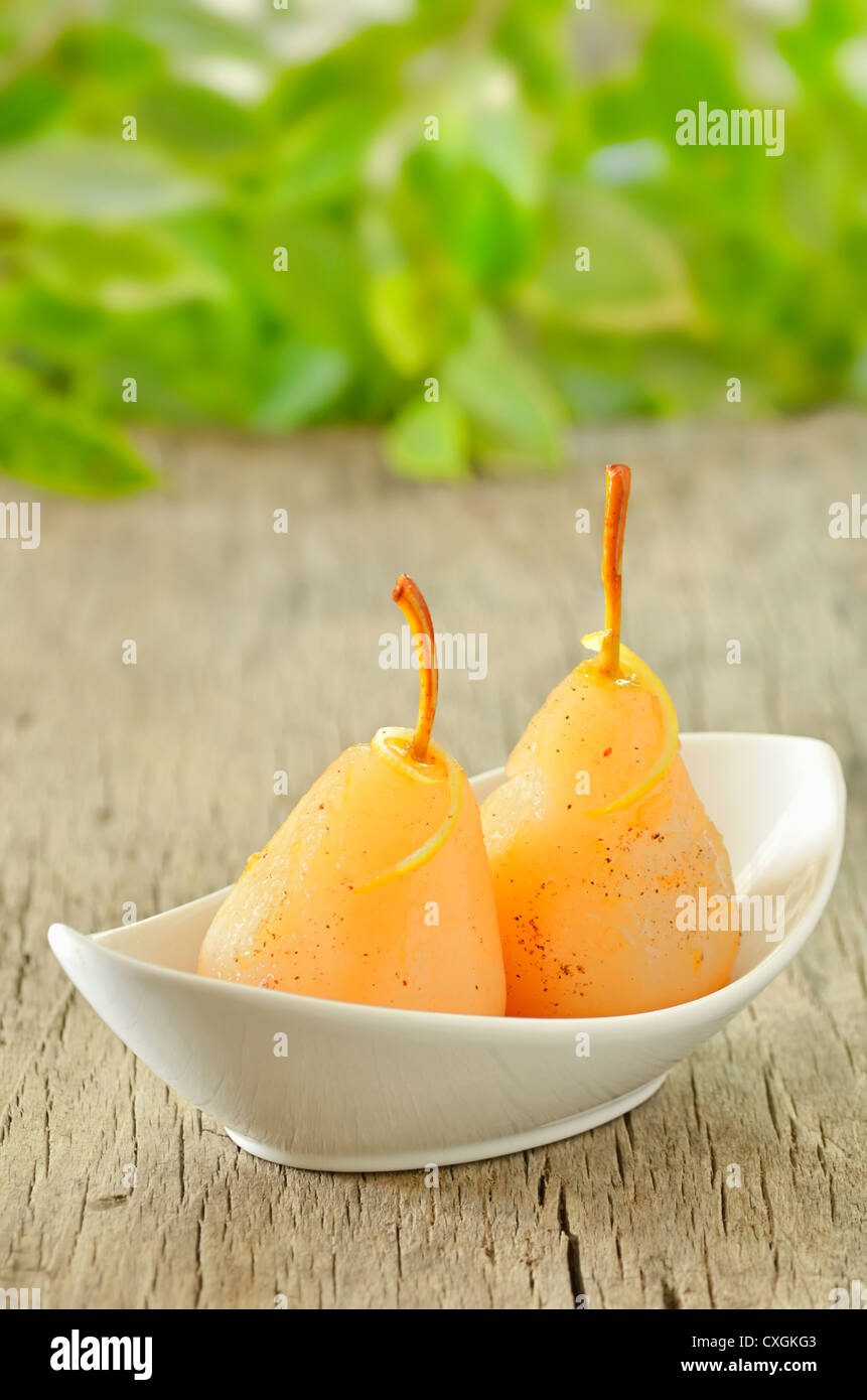 two pears poached in syrup Stock Photo