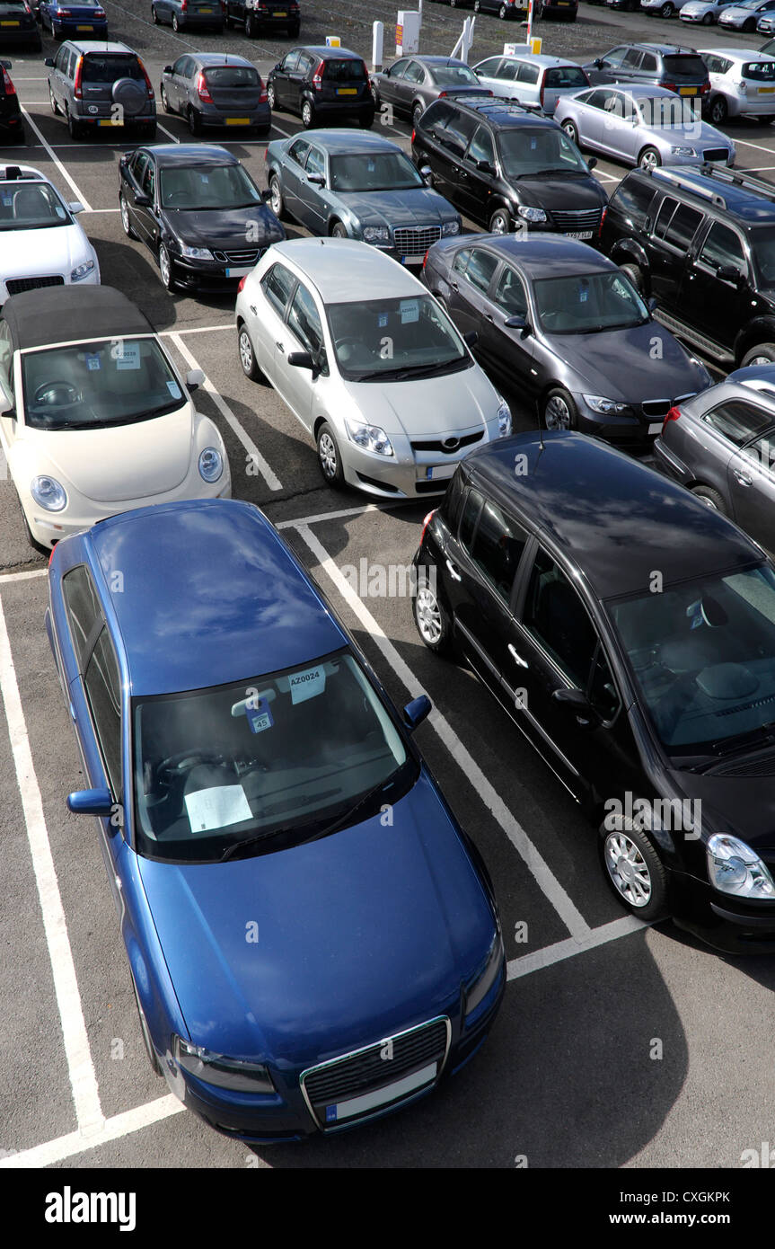 a selection of British right hand drive cars in car park seen from above. - Stock Image