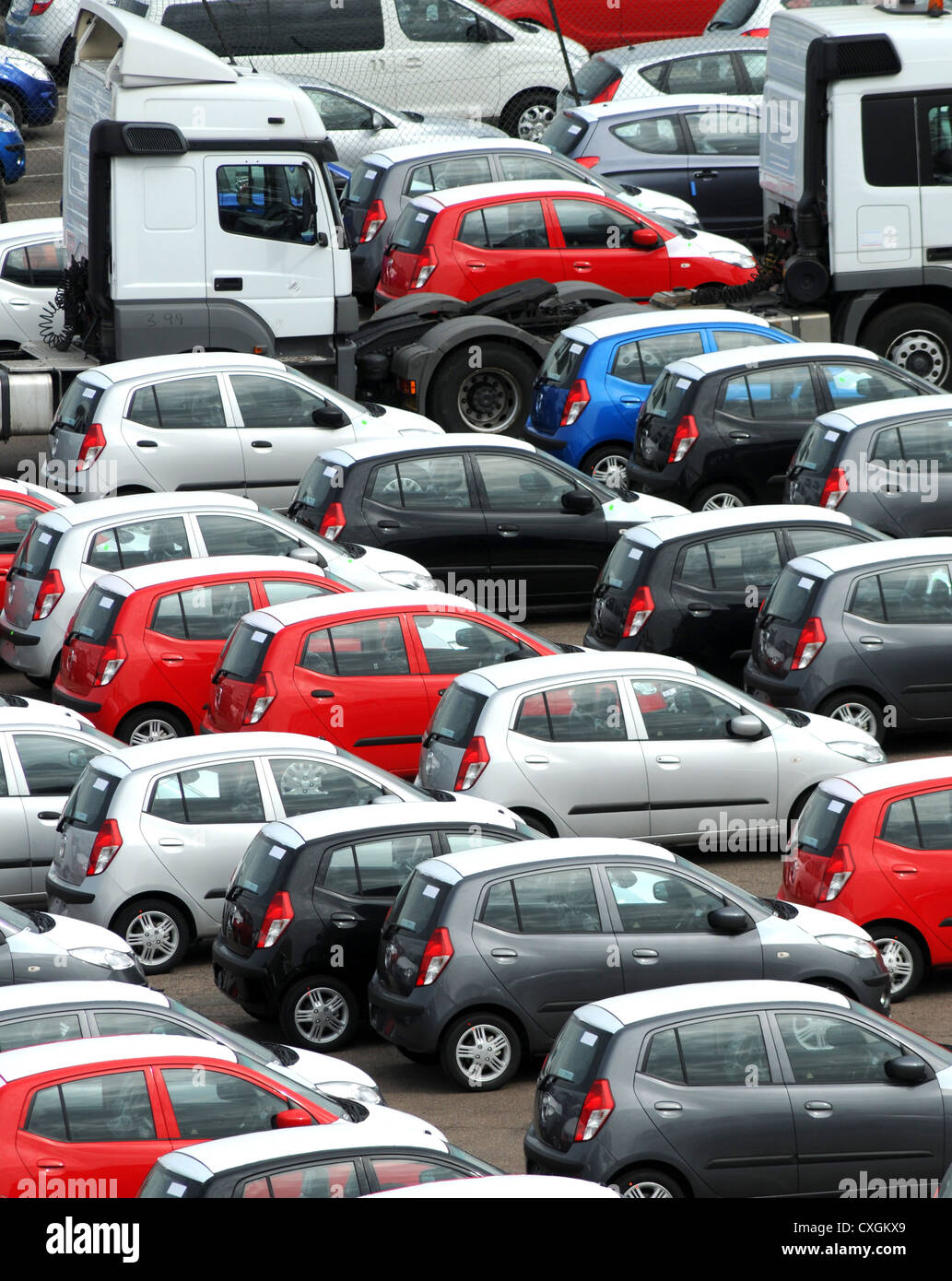 rows of newly imported multicoloured vehicles, cars and lorrys - Stock Image