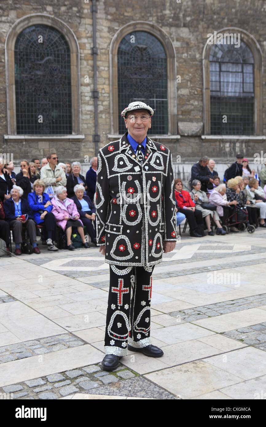 The Pearly Kings & Queens Costermongers' Harvest Festival held at Guildhall Yard, & St Mary-le-Bow Church, - Stock Image