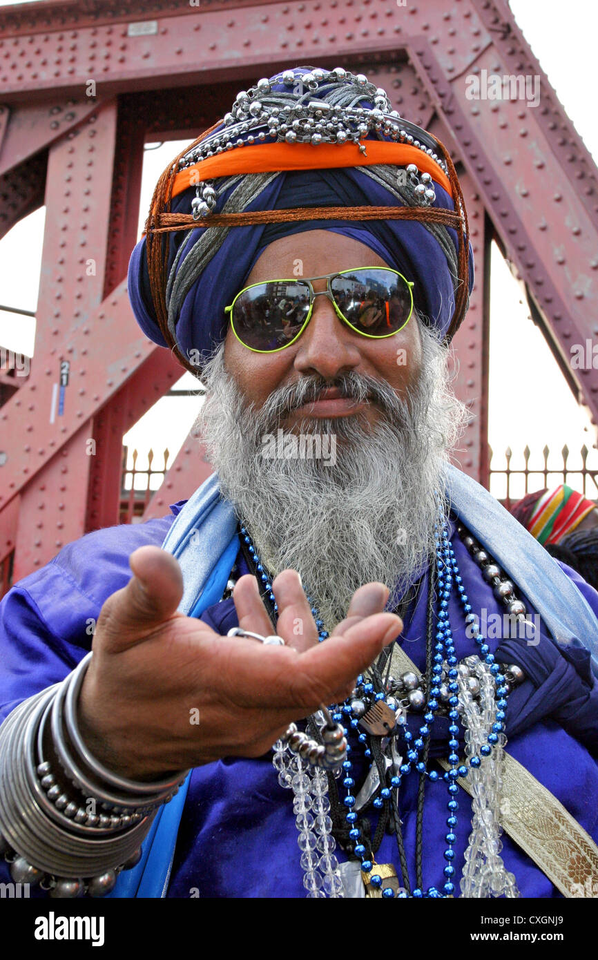 Adult man dressed in fancy Genie costume at festival - Stock Image