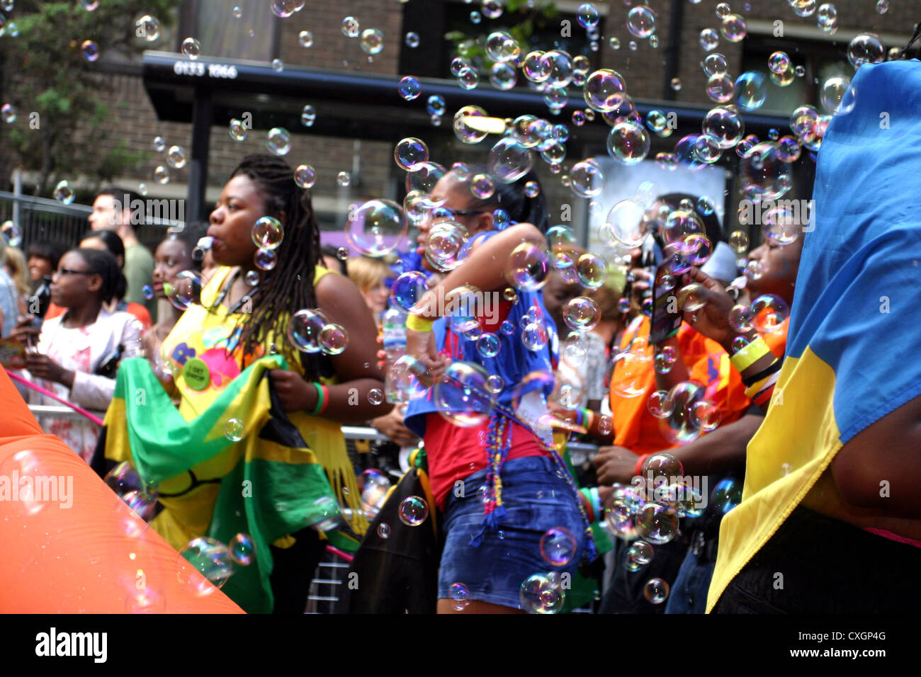 Bubbles floating in the air at Notting Hill annual Carnival London - Stock Image
