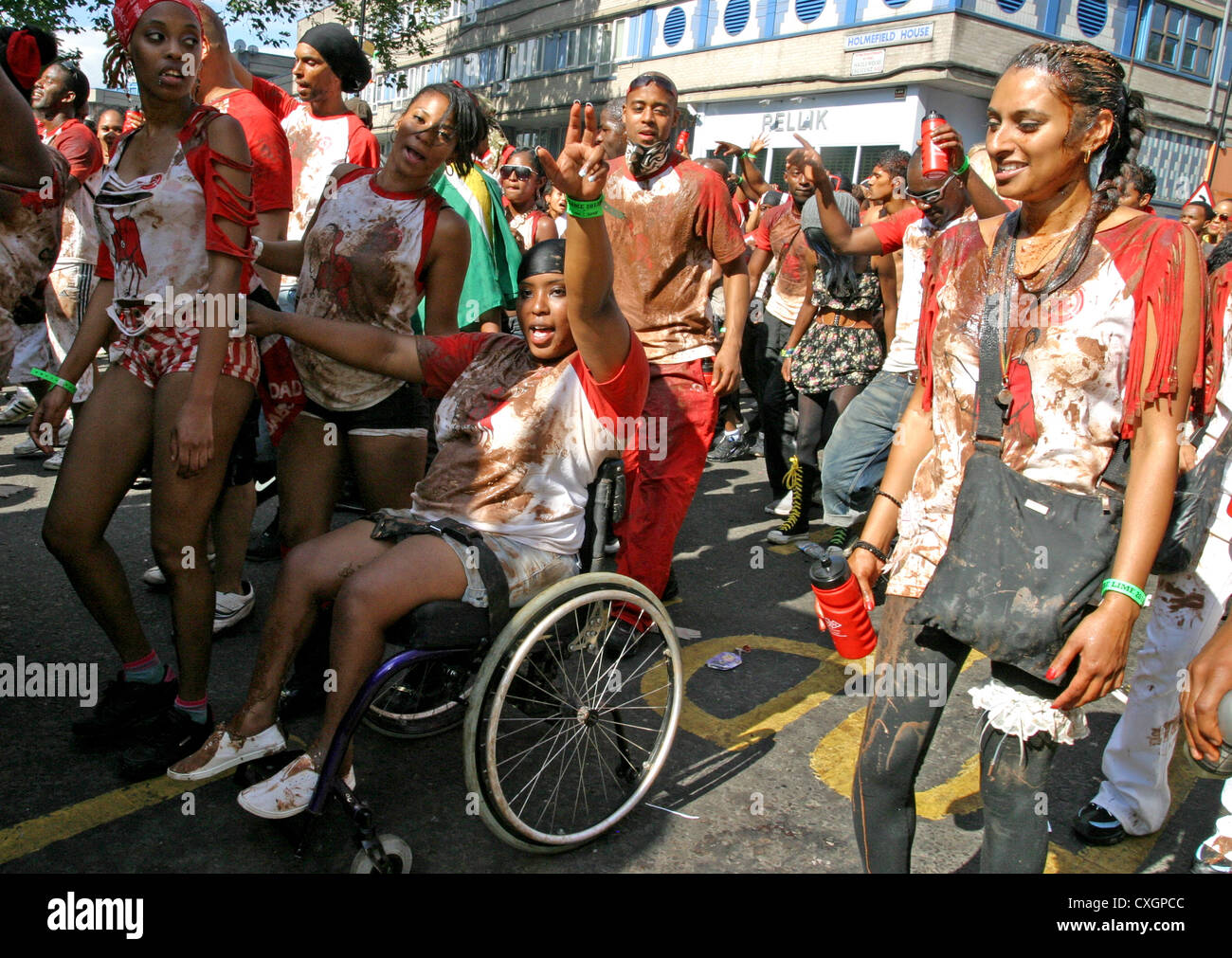 person in wheelchair taking part  in Notting Hill festival - Stock Image