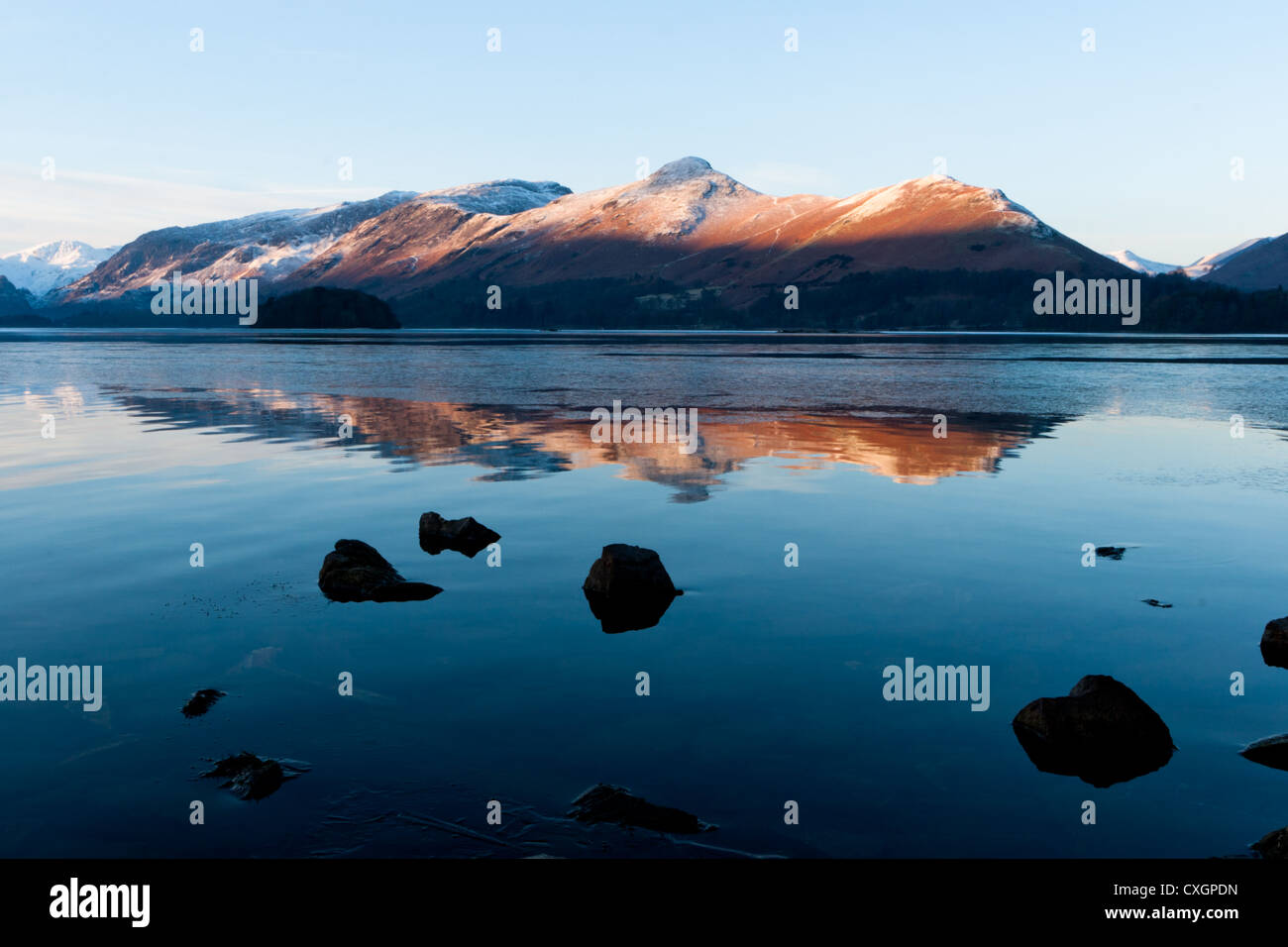 Catbells in winter, Lake district , Cumbria,  Ice, snow, blue, sky, cold, sunrise, mountains - Stock Image