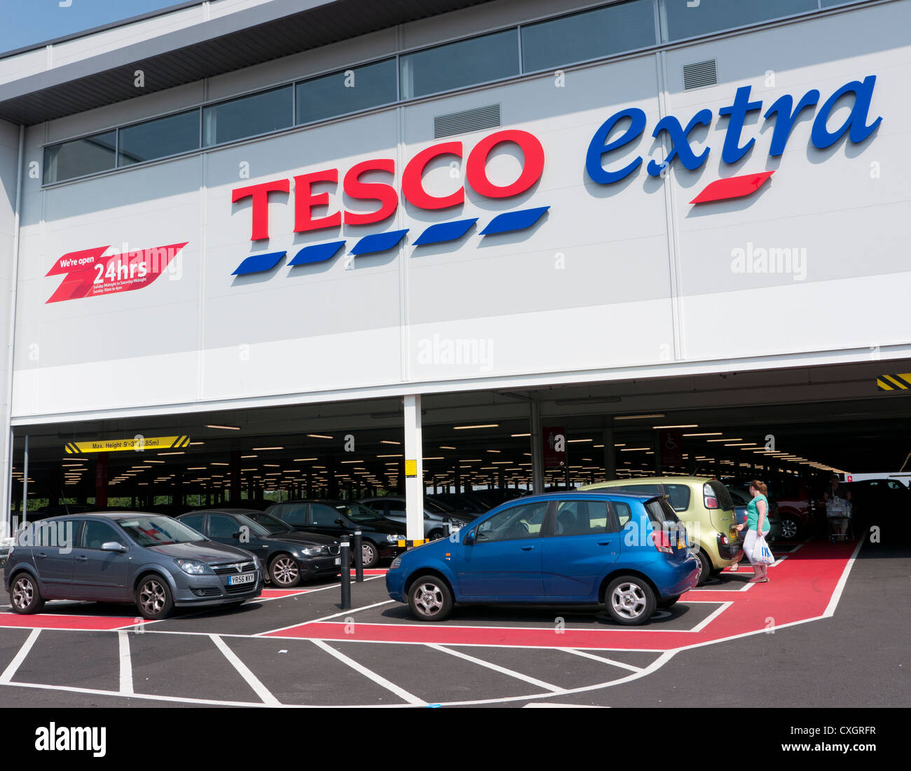 Tesco Extra in Britain with parking beneath the store for easy access - Stock Image