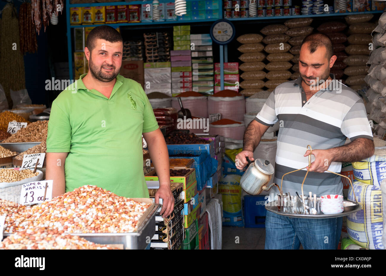 Tea valet serving a spice vendor in the old town of Ankara, capital of Turkey Stock Photo