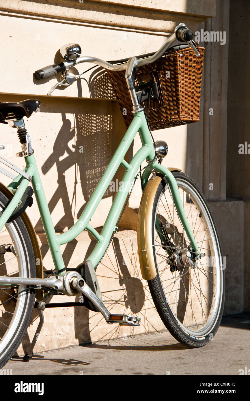 Bicycle leaning against wall in Paris, France Stock Photo