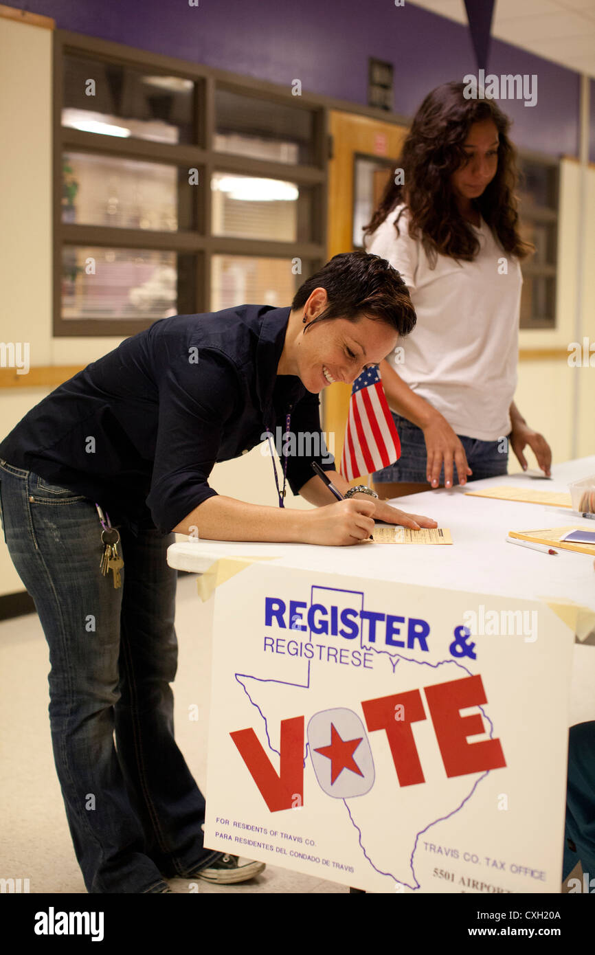 volunteers conduct a voter registration drive for 18-year-olds at High School in Austin, Texas. - Stock Image