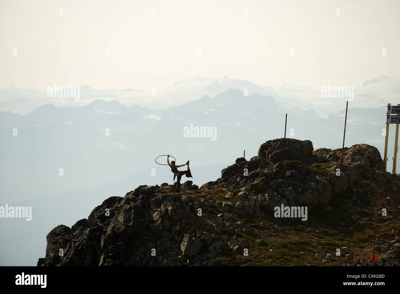 Hula Hoop artist working out at the top of Whistler Mountain.  Whistler BC, Canada - Stock Image