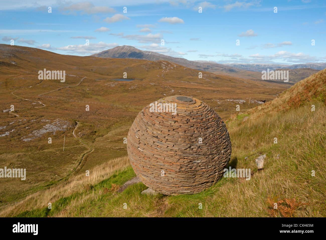 The Globe artwork by Joe Smith built from Moine Shist at Knockan Crag, NW Scotland.  SCO 8559 Stock Photo