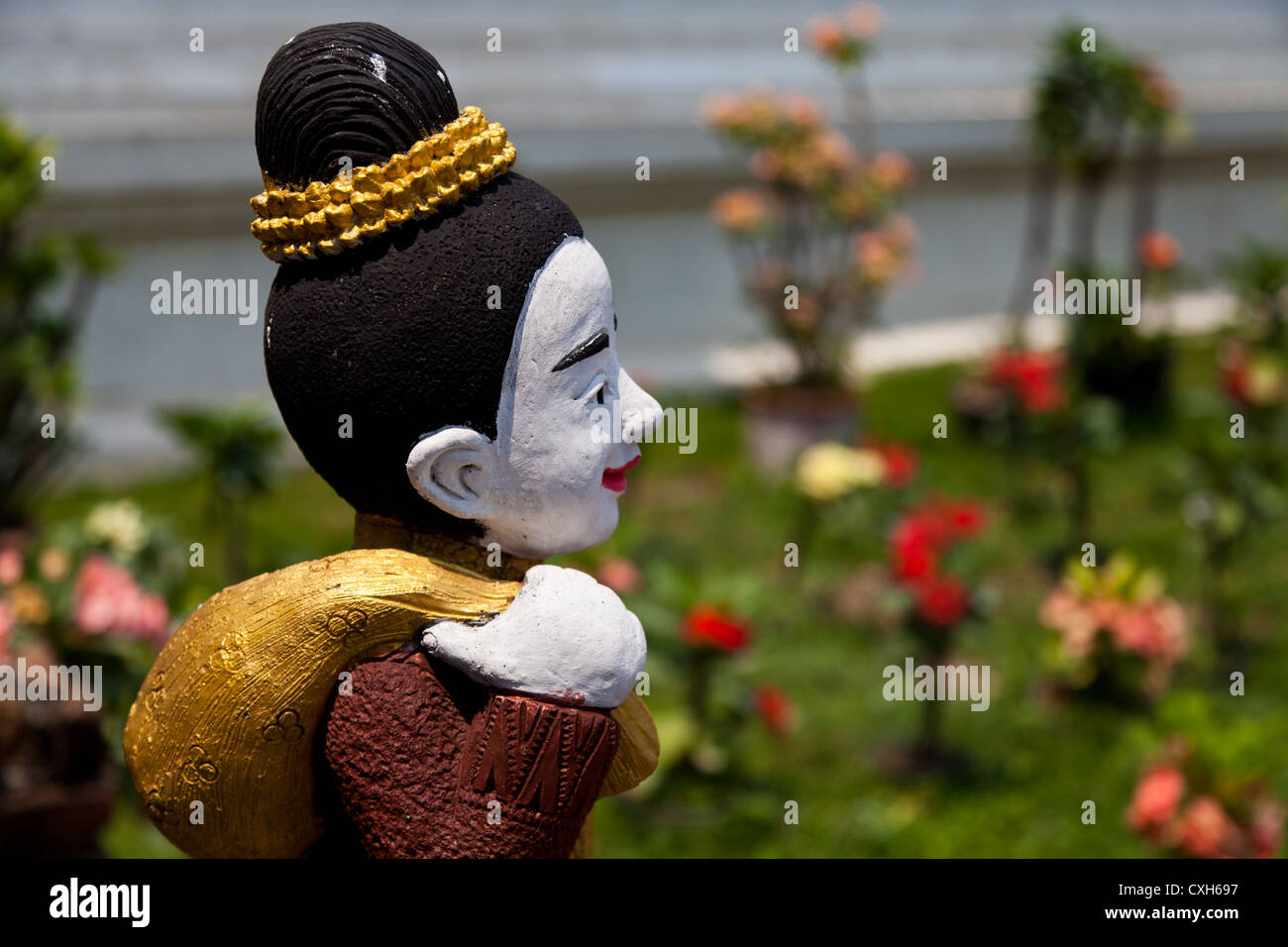 Little Statue in the Temple Wat Buppharam in Chiang Mai in Thailand Stock Photo