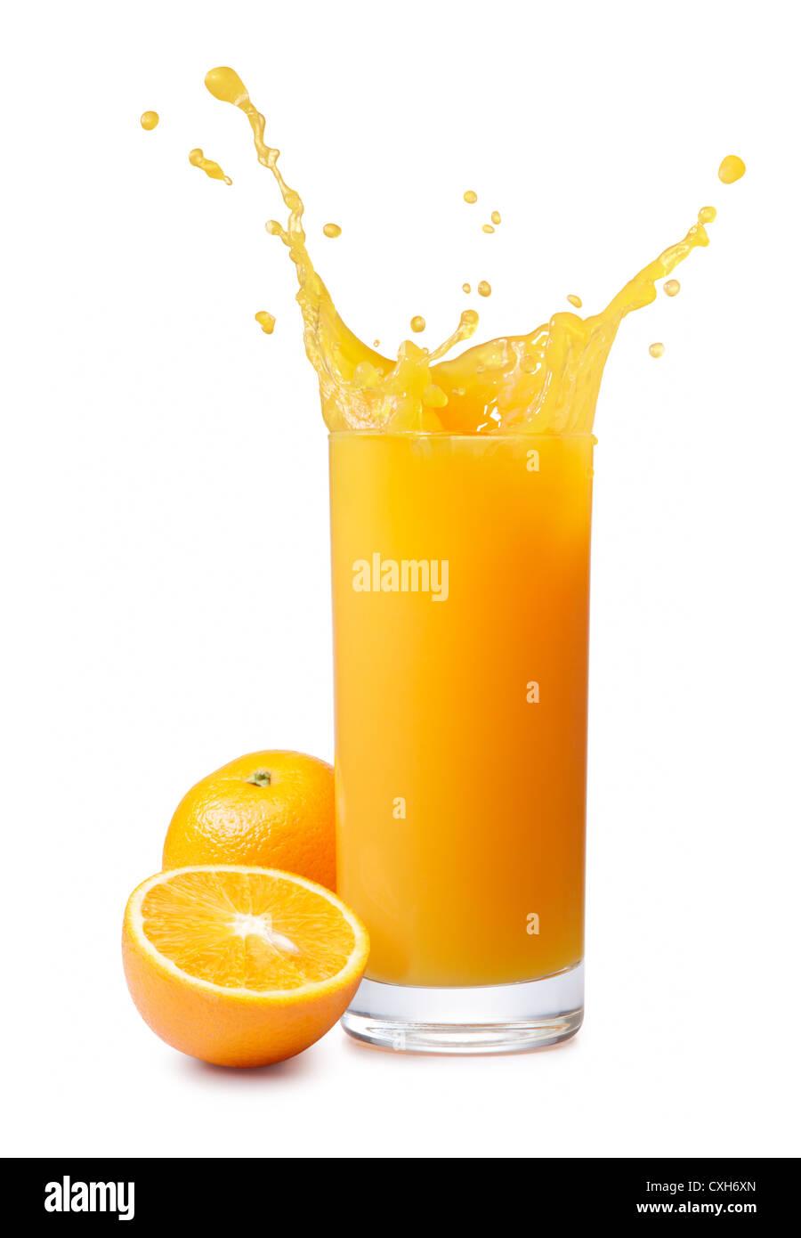 splashing orange juice with oranges isolated on white - Stock Image