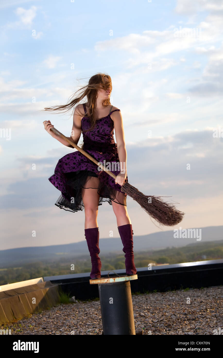 pretty witch with hat and broom stock photo 50780485 alamy