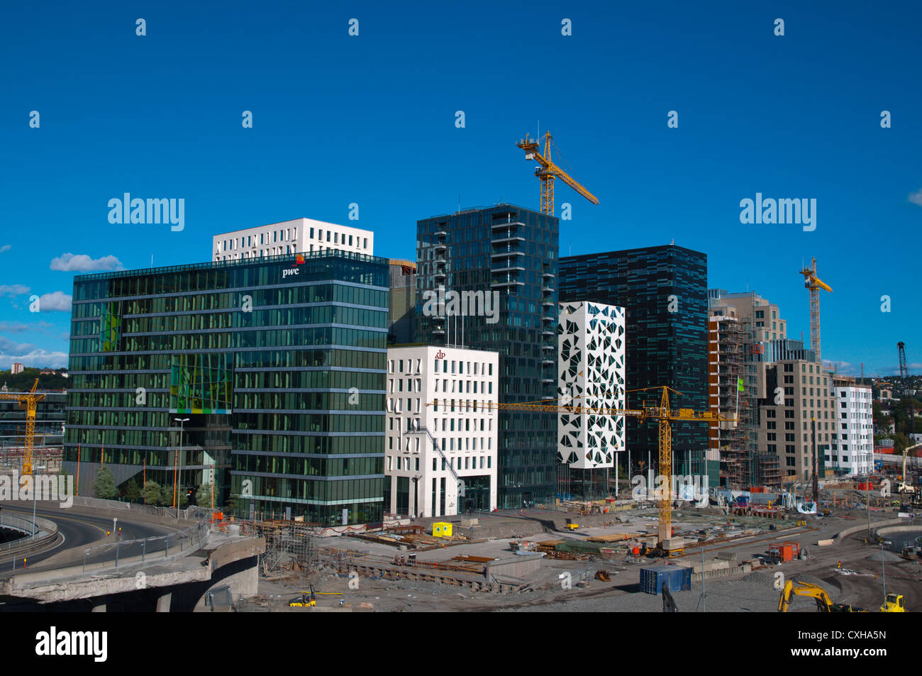New Fjord City district developments next to main railway station Bjorvika district Sentrum central Oslo Norway - Stock Image