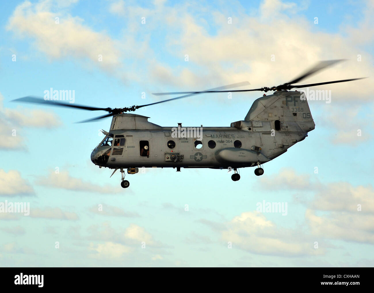 A CH-46E Sea Knight helicopter departs from amphibious dock landing ship USS Rushmore September 26, 2012. - Stock Image