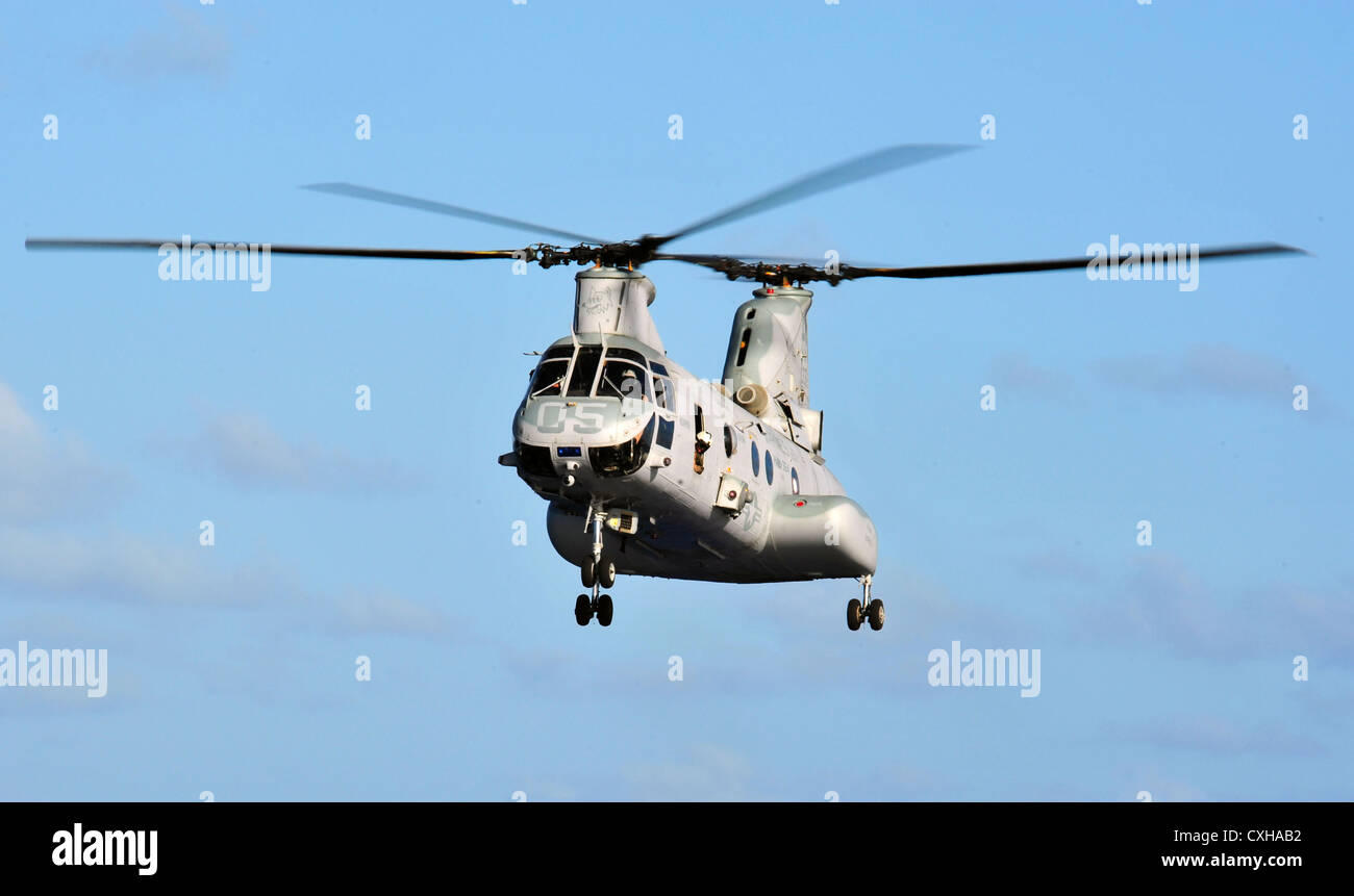 A CH-46E Sea Knight helicopter approaches amphibious dock landing ship USS Rushmore September 26, 2012. - Stock Image