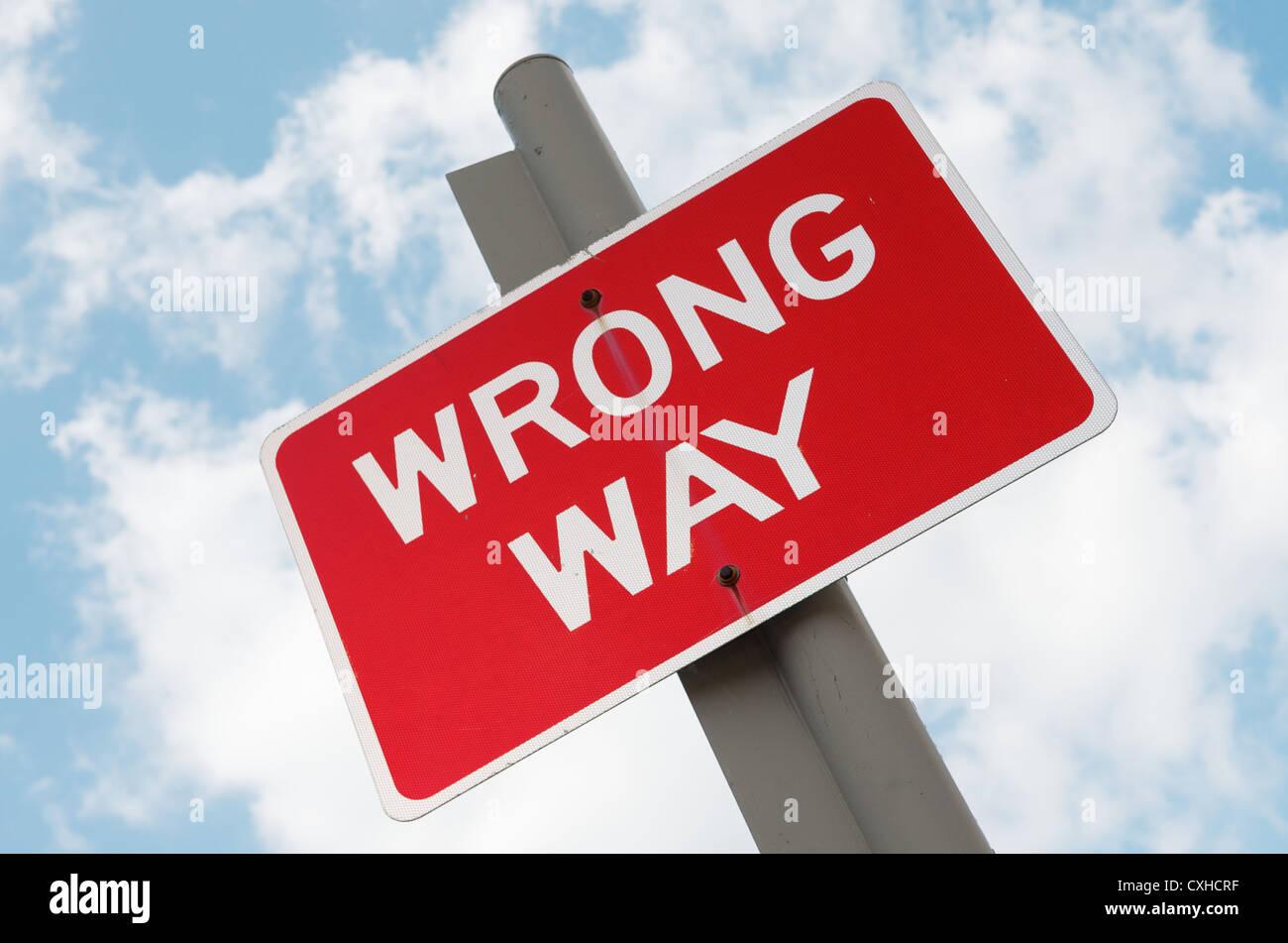 Wrong Way sign post - Stock Image