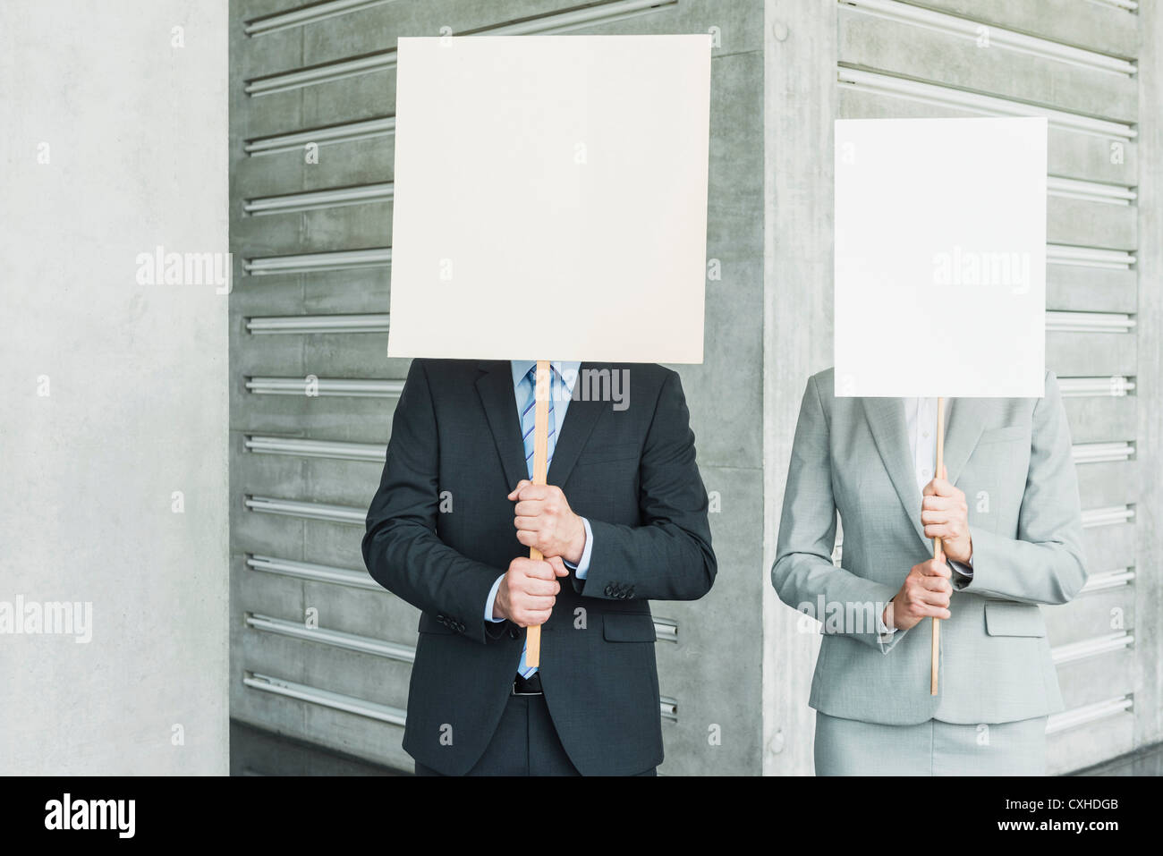 germany stuttgart business people holding blank signs in office