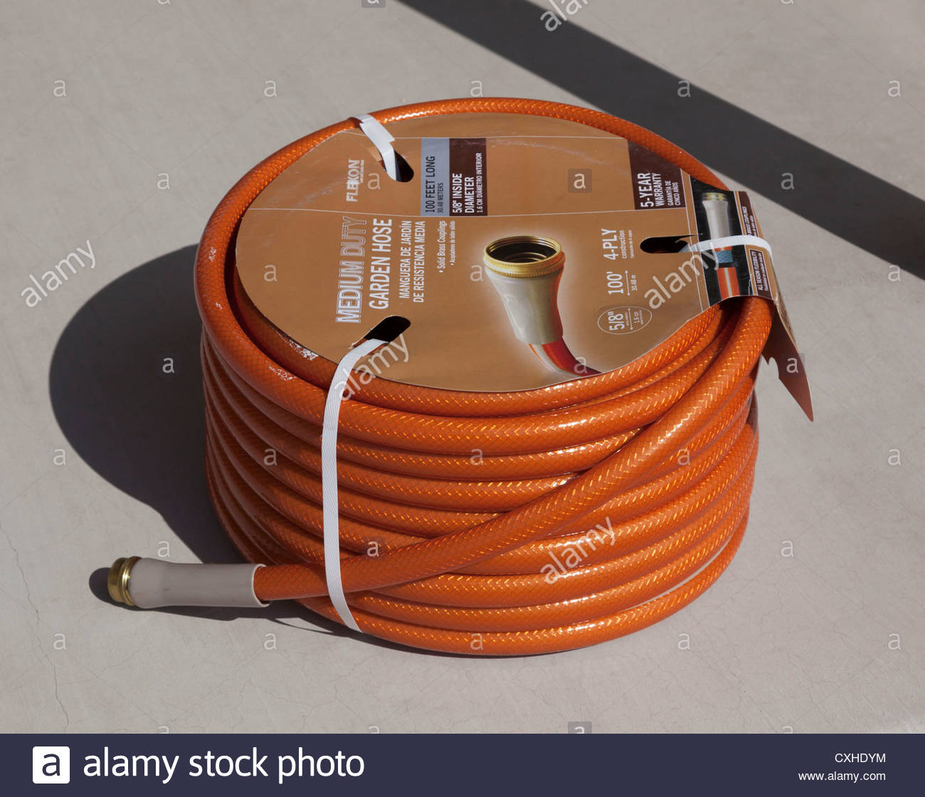 New 100 foot roll of garden hose copper colored on concrete label ...