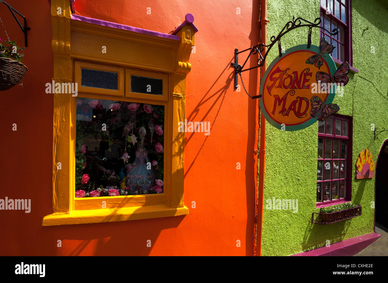 Brightly painted shop front off Market Square, Kinsale, County Cork, Ireland - Stock Image