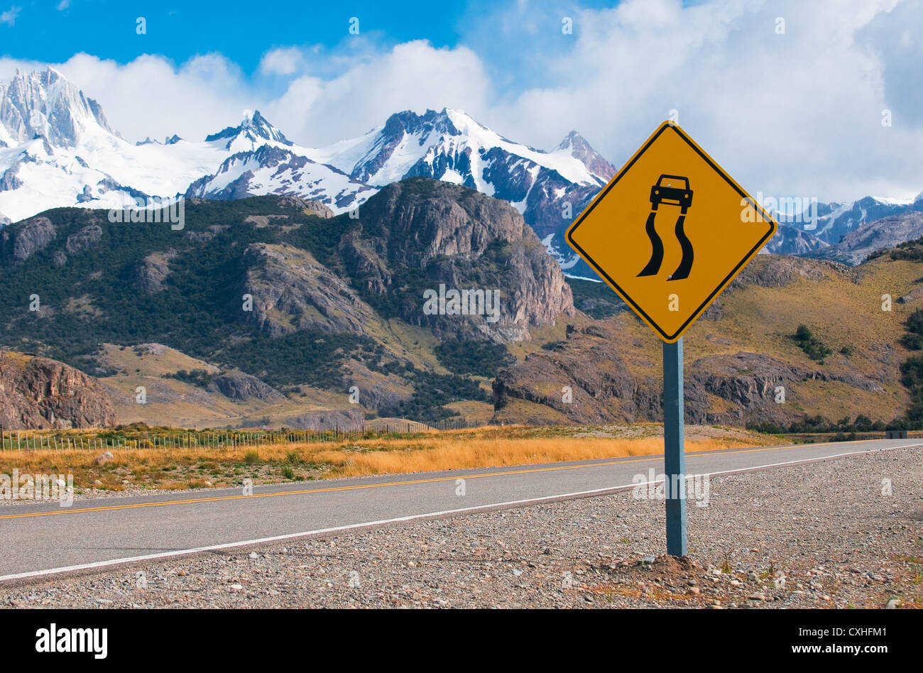 slippery when wet warning road sign - Stock Image