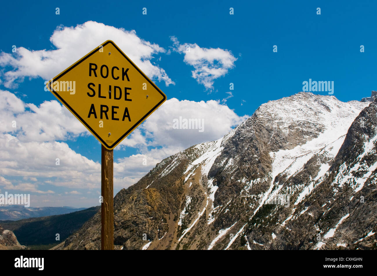 Rock slide area sign in the mountains - Stock Image