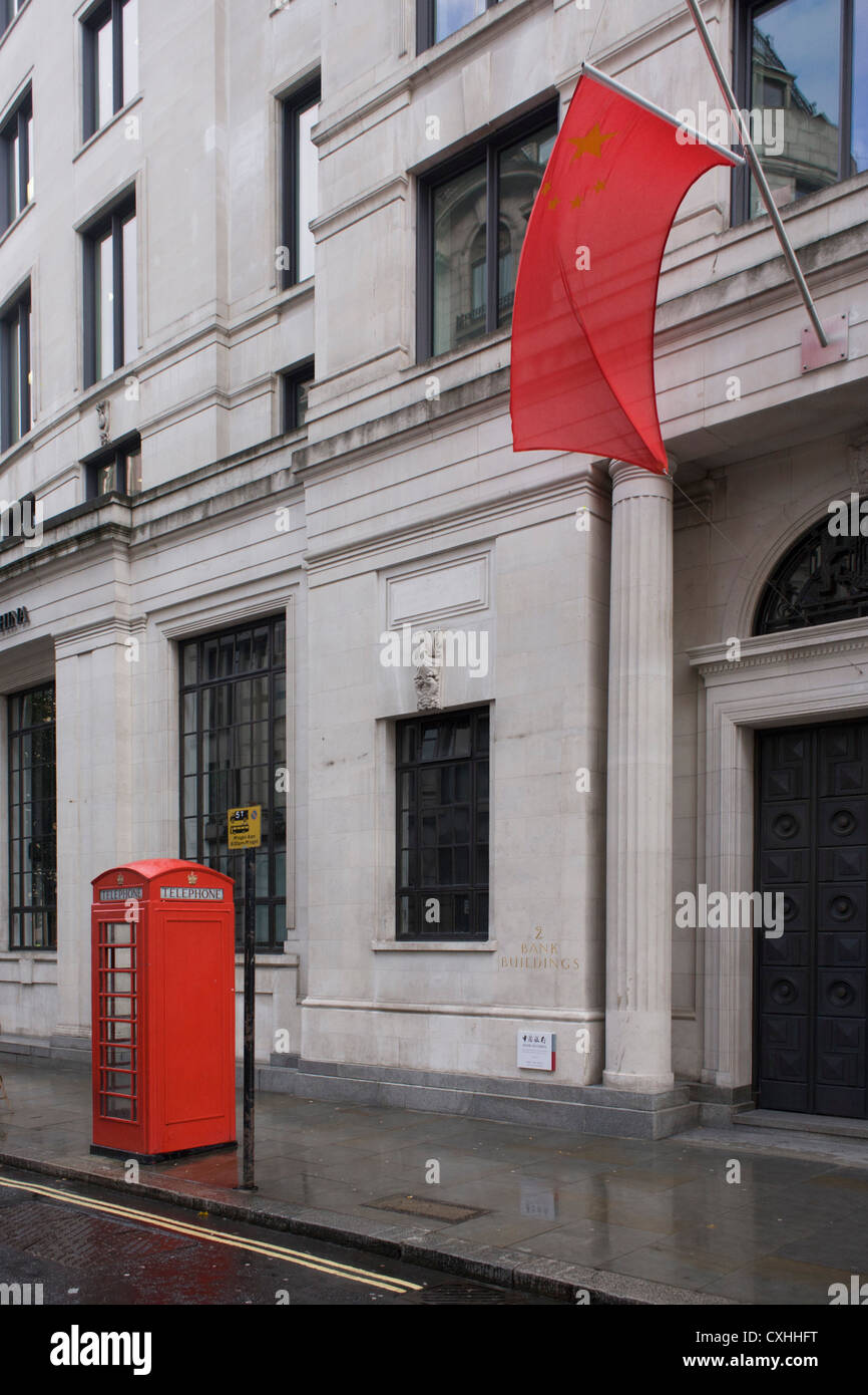City of London branch of the Bank of China with a red telephone kiosk. - Stock Image