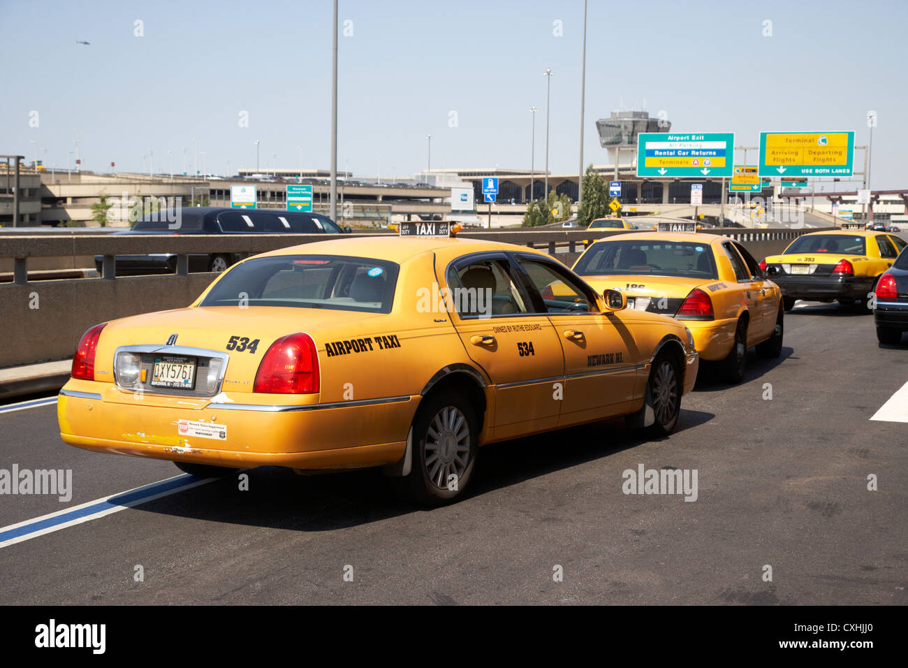 yellow cabs airport taxis at newark liberty airport new jersey usa - Stock Image